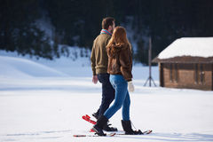 Couple having fun and walking in snow shoes Stock Photo