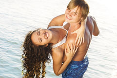 Couple having fun in the water Stock Photography