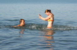 Couple having fun in water. Healthy lifestyle: couple having fun in water Royalty Free Stock Images