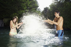 Couple Having Fun In Water Royalty Free Stock Image