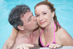 Couple having fun in the water summertime holidays Stock Image