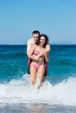 Couple having fun in the water Royalty Free Stock Photography