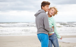 Couple  having fun wearing warm clothes outside Stock Photography