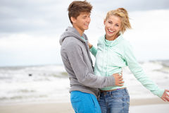 Couple  having fun wearing warm clothes outside Stock Photo