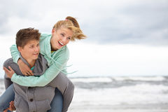 Couple  having fun wearing warm clothes outside Stock Images