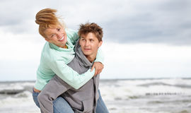 Couple  having fun wearing warm clothes outside Stock Image