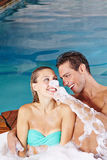 Couple having fun in whirlpool Royalty Free Stock Images