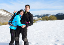 Couple having fun on winter hiking trip Royalty Free Stock Photo