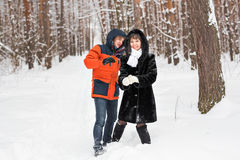Couple having fun in winter park on a bright day laughing and smiling Stock Images