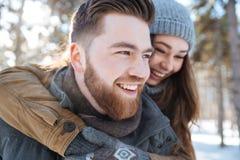 Couple having fun in winter park Royalty Free Stock Photos