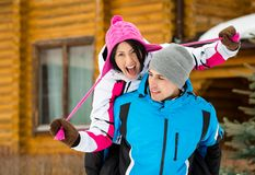 Couple having fun during winter vacations Stock Image