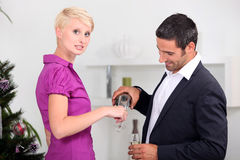 Couple having glass of champagne Stock Photos