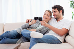 Couple having a glass of red wine Stock Image