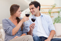 Couple having a glass of wine Royalty Free Stock Images