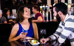 Couple having a glass of wine Stock Image