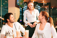 Couple Having A Good Time in Cafe Stock Photos
