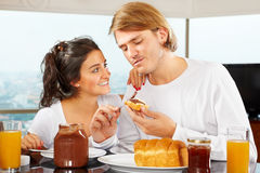 Couple having great time on breakfast Royalty Free Stock Image