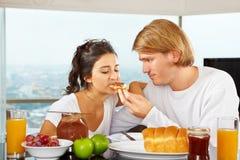 Couple having great time on breakfast Stock Photos