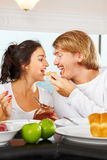 Couple having great time on breakfast Royalty Free Stock Photo