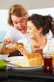 Couple having great time on breakfast Stock Photos