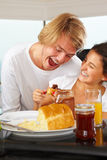 Couple having great time on breakfast Stock Photo