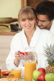 Couple having a healthy breakfast. Couple enjoying a healthy breakfast Royalty Free Stock Images