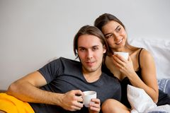 Hot coffee in bed. Couple having a hot coffee in bed Stock Photos