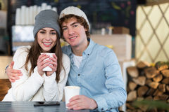 Couple having hot drink on winter day Stock Image