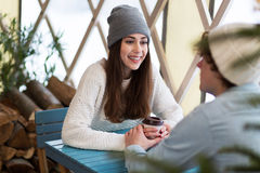 Couple having hot drink on winter day Stock Images