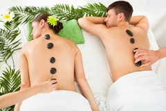 Couple having a hot stone massage Royalty Free Stock Photos