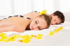 Couple having a hot stone massage Stock Photo