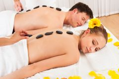 Couple having a hot stone massage Stock Image