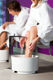 Couple having hydrotherapy water footbath Stock Image