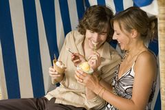 A couple having ice cream. A couple having ice cream Royalty Free Stock Photography