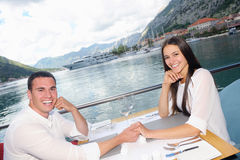Couple having lanch at beautiful restaurant Stock Photos