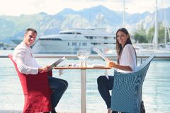 Couple having lunch at beautiful restaurant Royalty Free Stock Images