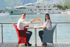 Couple having lunch at beautiful restaurant Stock Photos