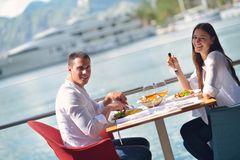 Couple having lunch at beautiful restaurant Stock Images