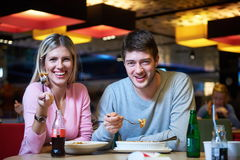 Couple having lunch break in shopping mall Stock Images