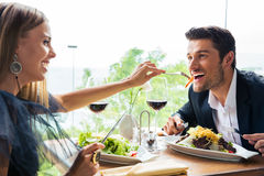 Couple having lunch in restaurant Royalty Free Stock Photos