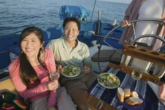 Couple having lunch on sailboat Stock Photo