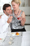 Couple having meal Stock Images