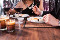 Couple Having Meal At Restaurant Stock Images