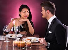 Couple having meal in restaurant Royalty Free Stock Photography