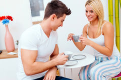 Couple having morning coffee at home Stock Images