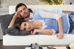 Couple having a nap Royalty Free Stock Photography