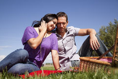 Couple having a picnic Stock Photos
