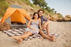 Couple having picnic at the beach Stock Photo