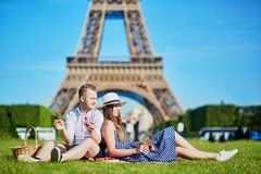 Couple having picnic near the Eiffel tower in Paris, France Stock Photos