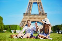 Couple having picnic near the Eiffel tower in Paris, France Royalty Free Stock Photography